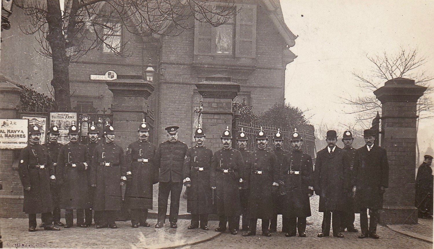 POLICEMEN LINE UP OUTSIDE DUDLEY ROAD POLICE STATION EARLY 1900. WITH SUMMERFIELD PARK ENTRANCE BEHIND.