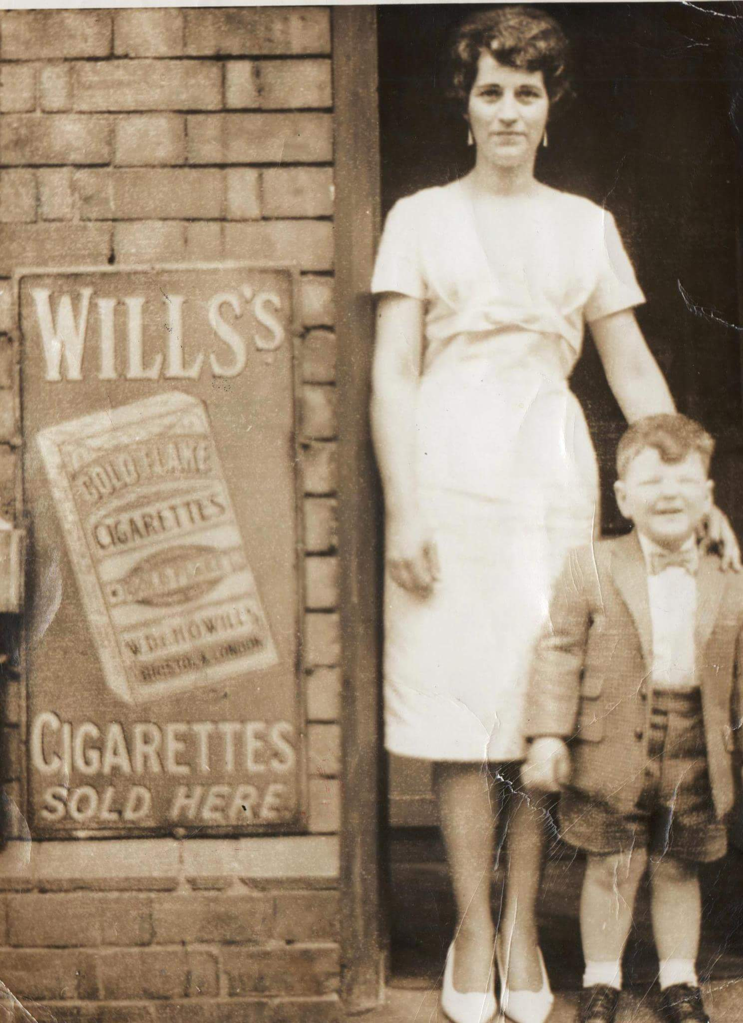 THIS IS A PHOTOGRAPH OF MY MOM AND ME OUTSIDE CORRIGANS TOBACCONIST HINGESTON STREET 1960.  Regards Tony Tombes 2\43 Hingeston Street  tombes58@hotmail.com