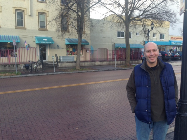 David Moreland, manager of the building behind him that houses Mama Goose, Mimi's Attic, Bishops Carpet One, and other offices and apartments. Photo: Karim Beers