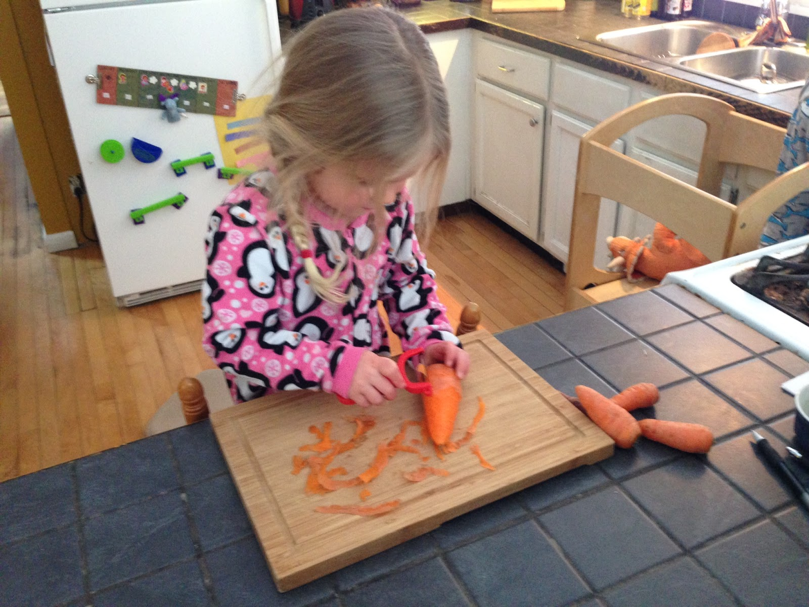 Erin's daughter peeling carrots from their CSA. Picture: Erin Eldermire