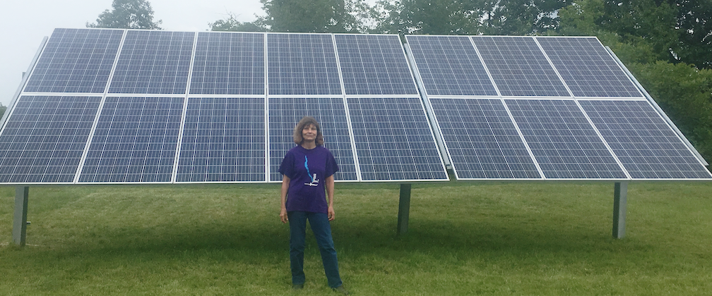 Gail Neely with her solar system in her front yard.