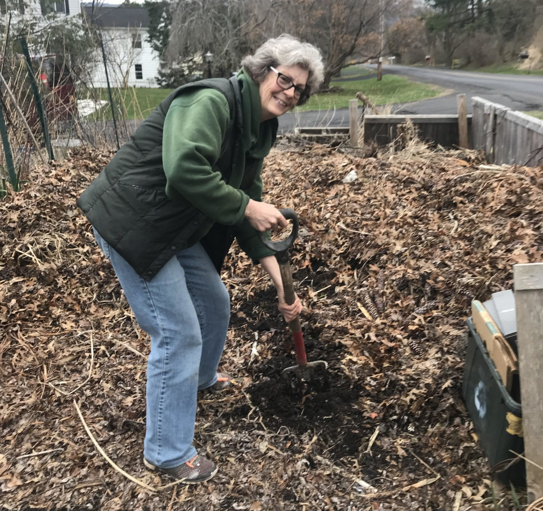 Pat Dutt works on her compost pile. Photo Courtesy of Laura Komor.