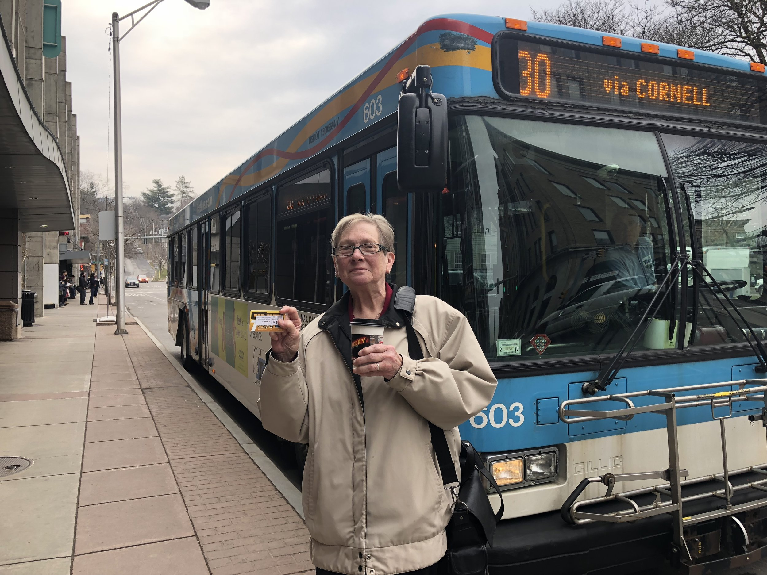 Kim Falstick poses in front of the Seneca Street TCAT stop. Kim gave up her car in 2005 and has seen the benefits of public transportation manifest in every aspect of her life!