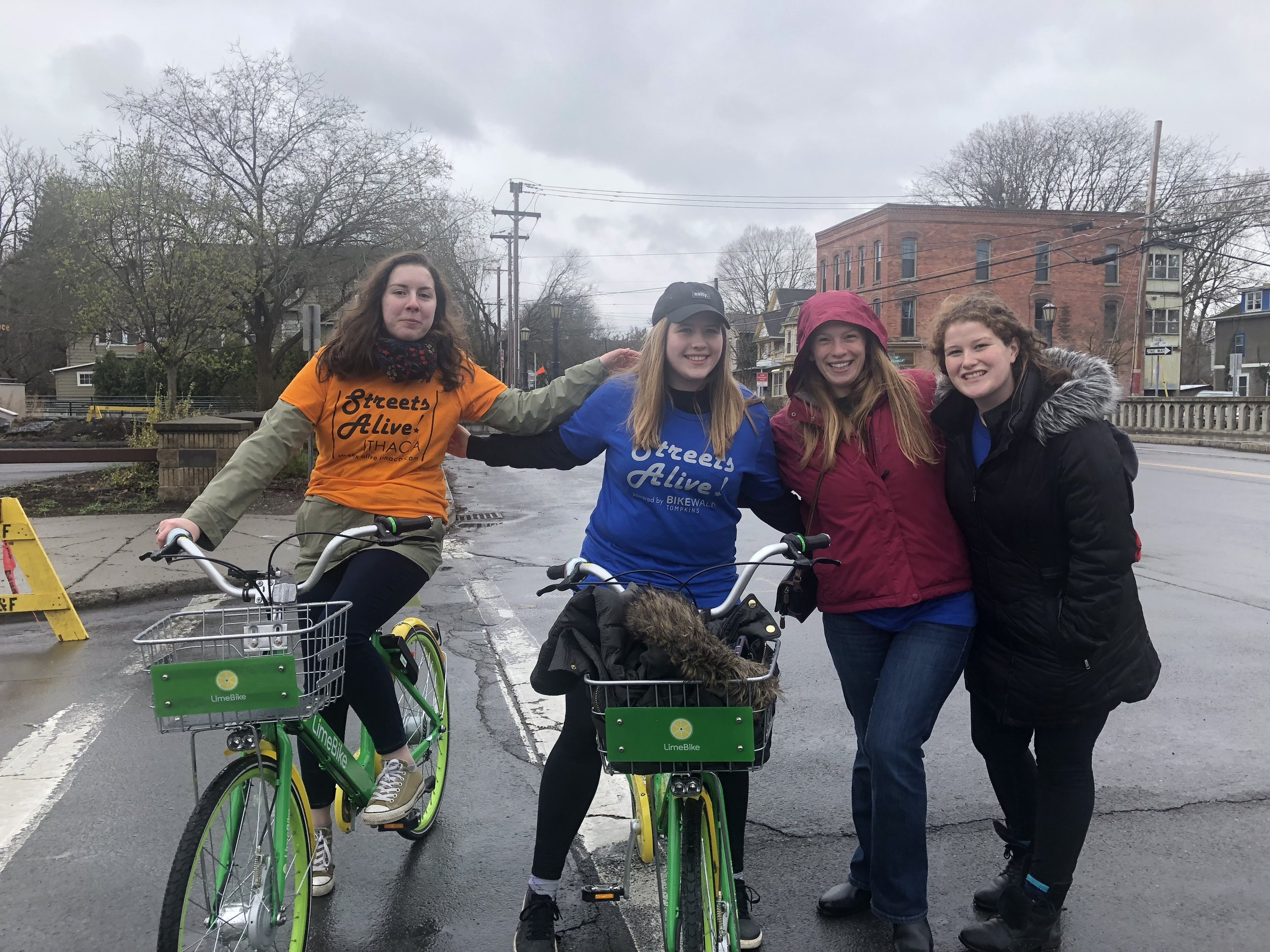 Ithaca College students Stephanie Mooney and Christie Bednarz pose on LimeBikes with two friends at StreetsAlive! They volunteered at StreetsAlive! representing their film fraternity, DKA.  Photo: Maggie McAden