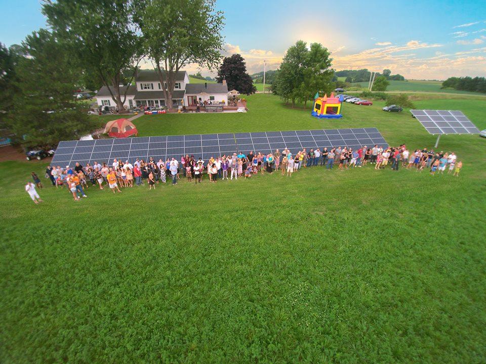 Tha Halco Energy team poses with a recently installed solar array   Photo courtesy Halco Energy