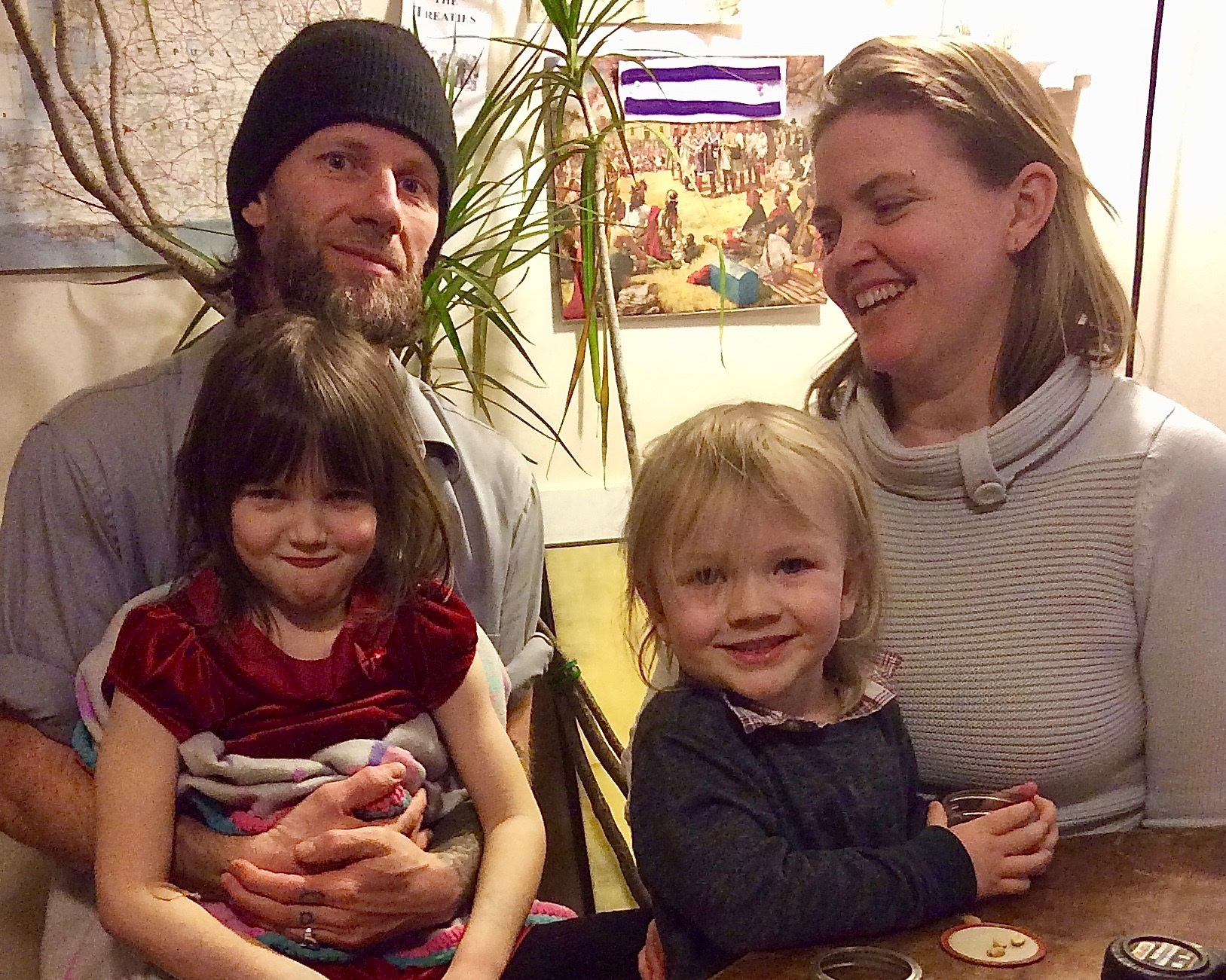 Aislyn Colgan and Harry Pruyne pose with their children Emerald and Padrick. In winter of 2018, Aislyn had work done on her home at a reduced cost through EmPower New York, a state program that helps subsidize energy work. Photo courtesy  Sustainable Tompkins .