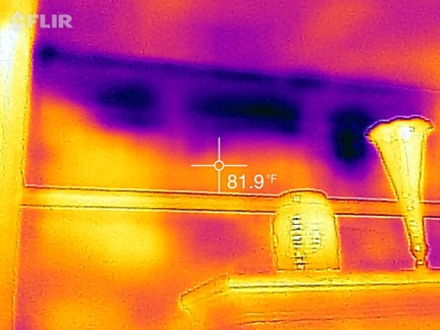 Dark spaces indicate cooler areas where insulation in wall cavities have settled. Credit: Karim Beers
