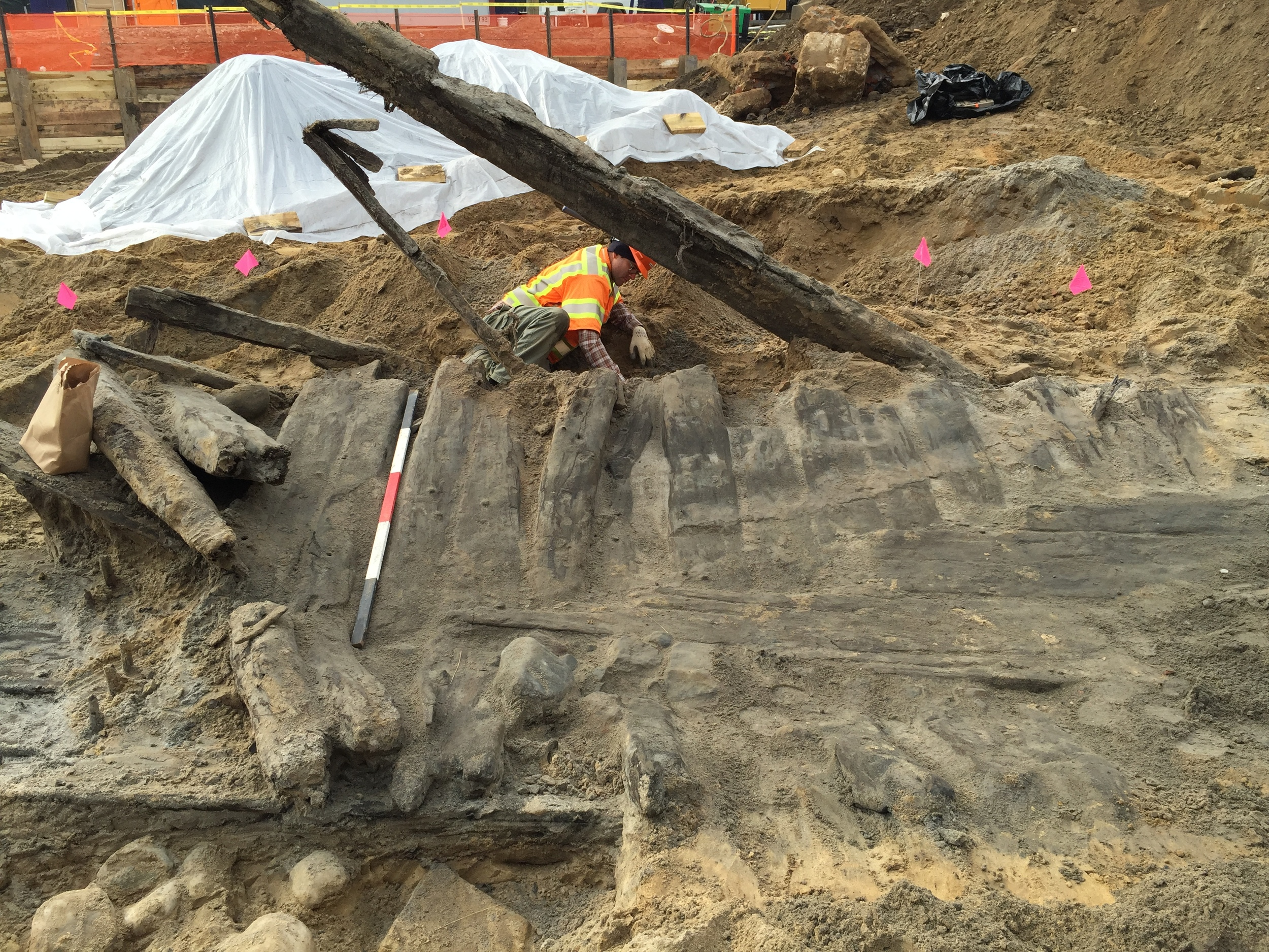 WSSI archeologist Edward Johnson hand excavates around the ship's hull to recover artifacts.