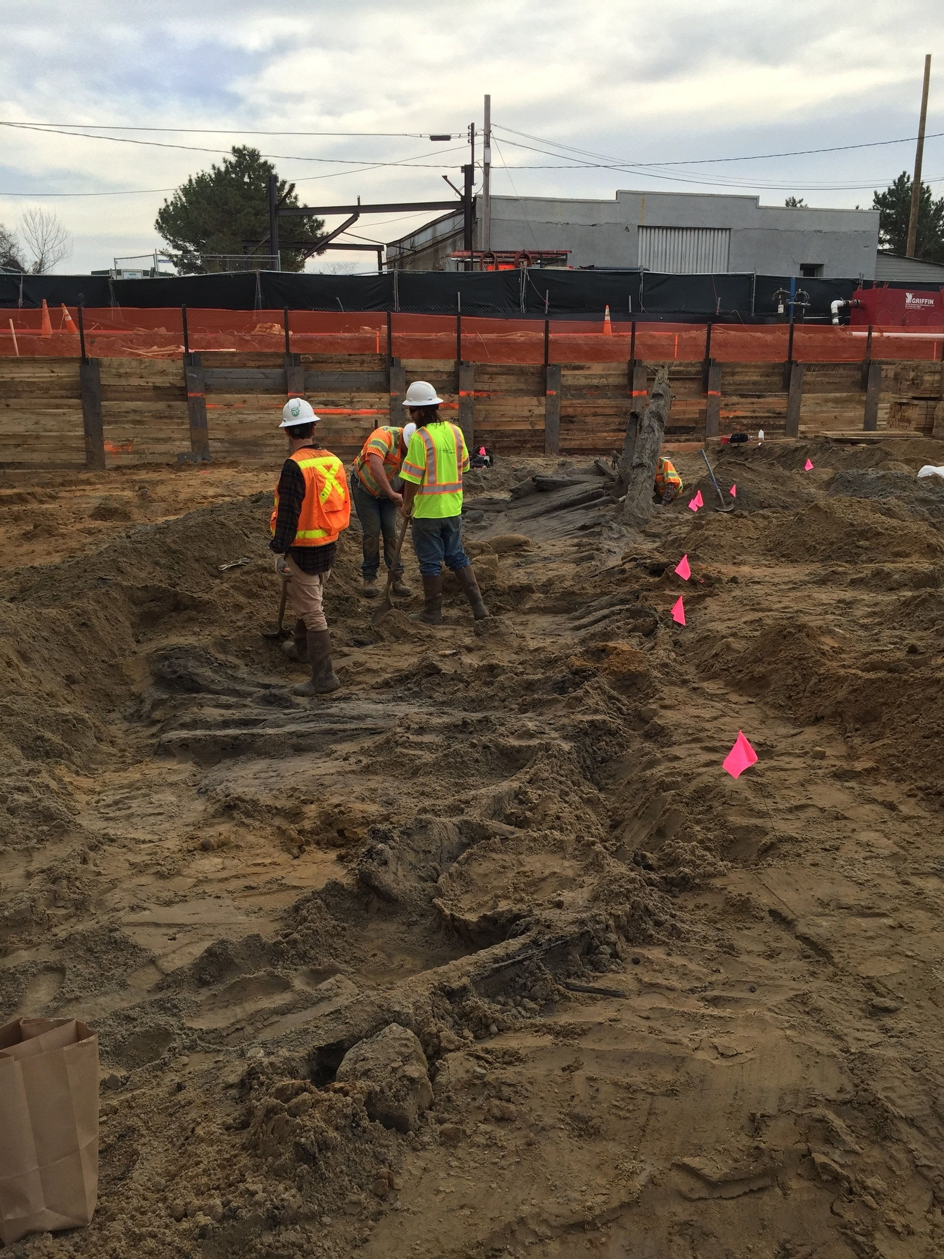WSSI archeologists Vince Gallacci, Daniel Osborne, and Daniel Baicy work to uncover the ship's hull.