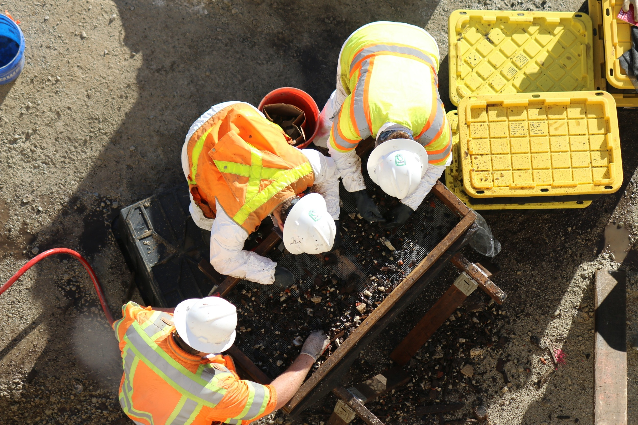 Dan Baicy, Kate Mott and Vince Gallacci water screening privy soils.