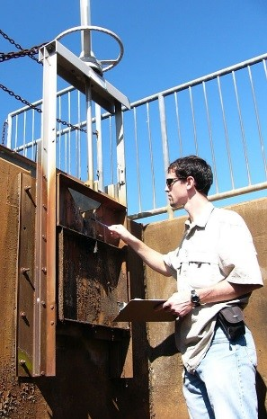 WSSI engineer inspecting a dam