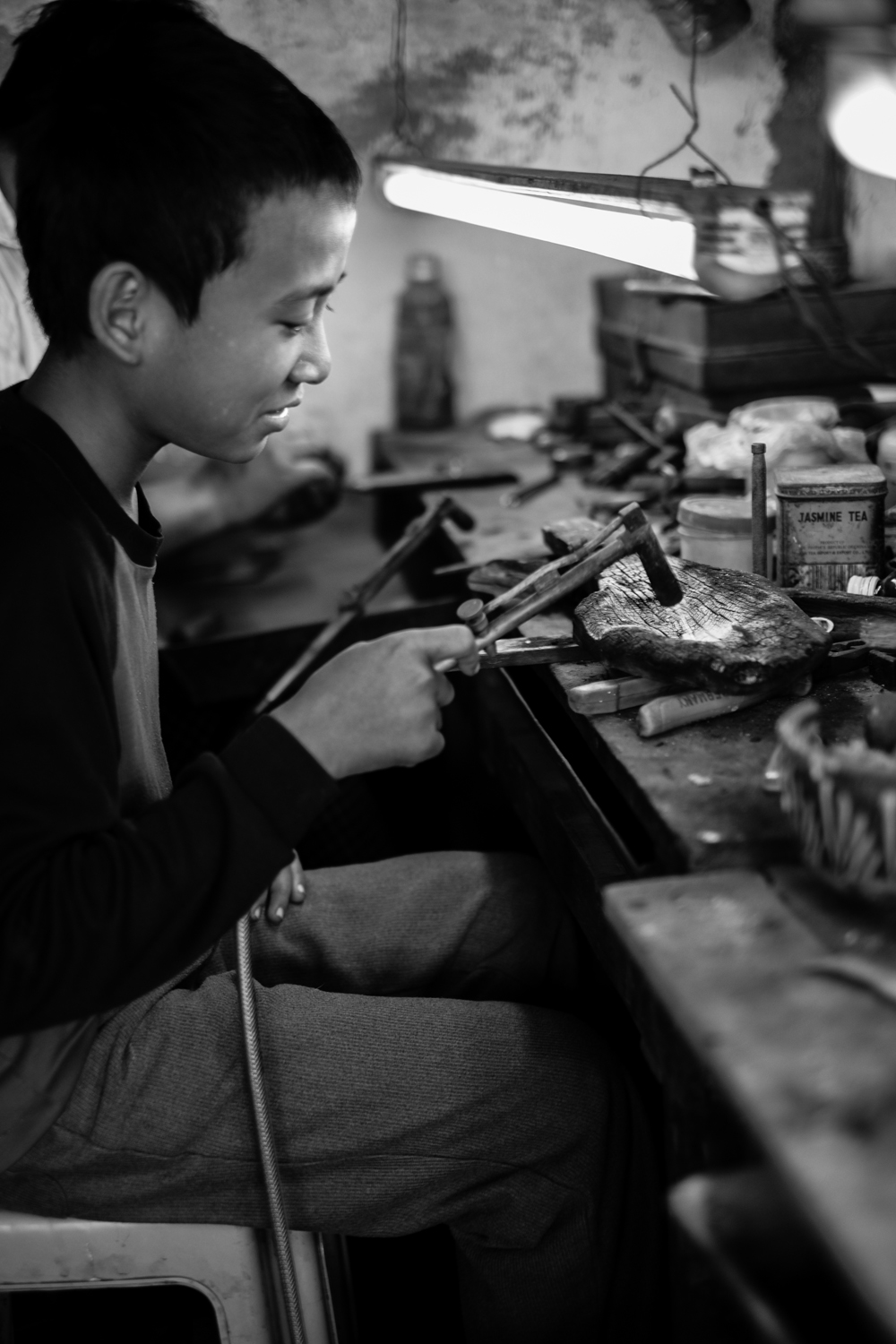 Young boy in Myanmar learning the trade.