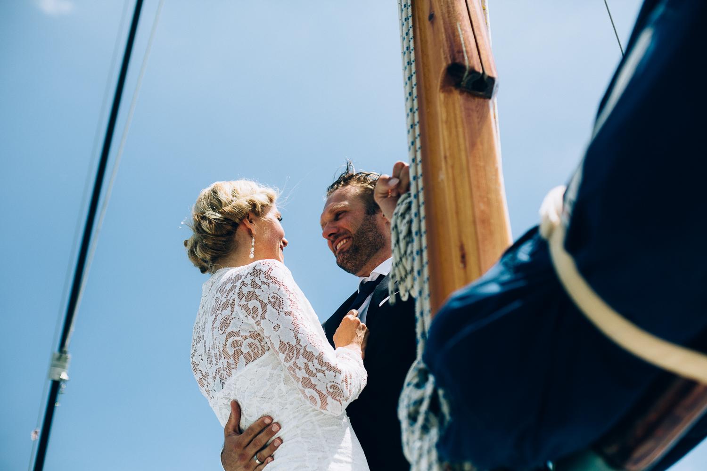 bride-groom-on-boat-smiling.jpg
