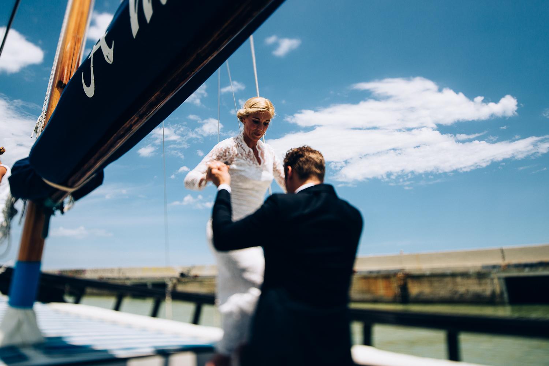 groom-helps-bride.jpg