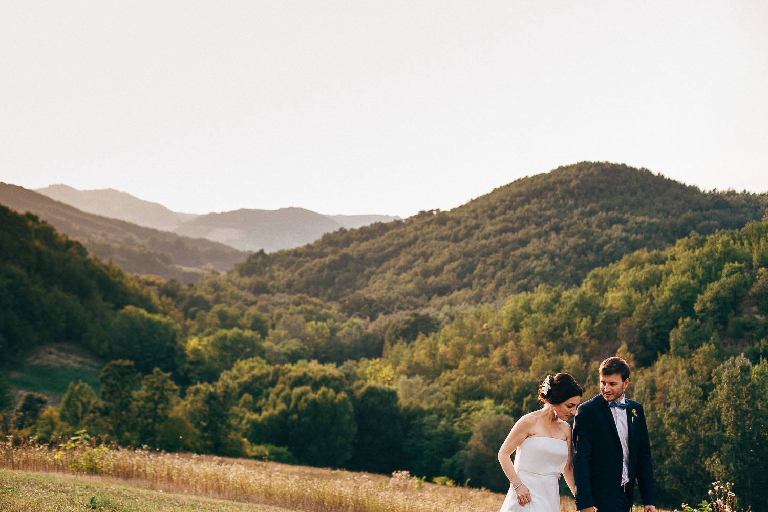 bride-groom-walking-hills.jpg