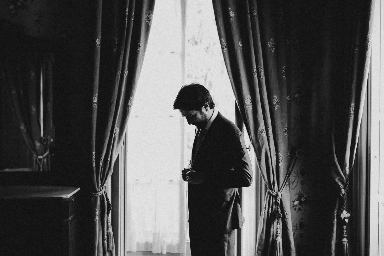 32-groom-getting-ready-portrait.jpg