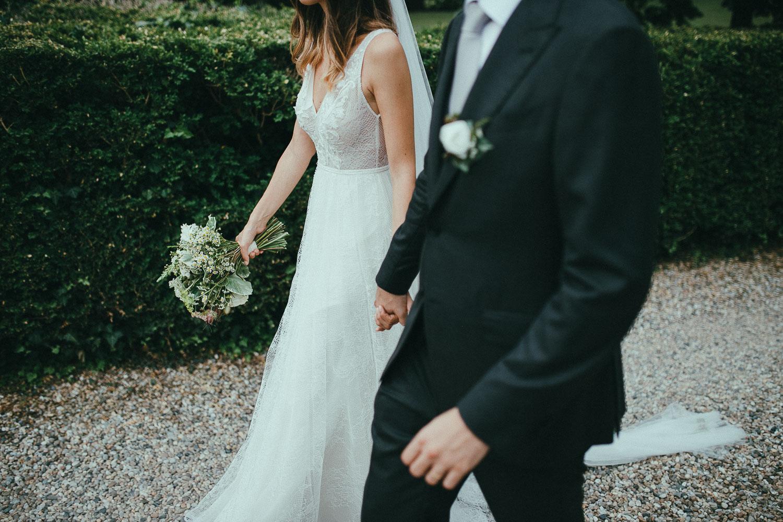 79-bride-and-groom-walking.jpg