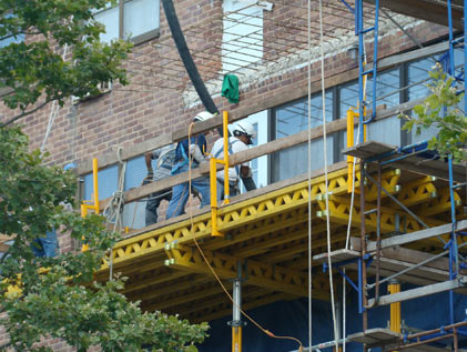 Forming and pouring new balconies