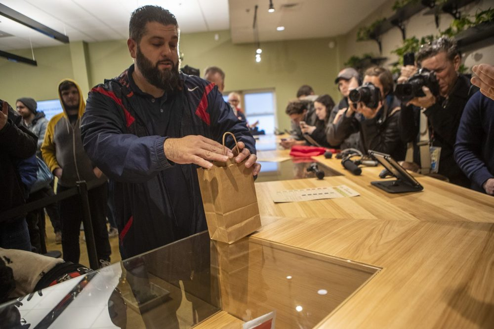 Veteran Stephen Mandile, a former sergeant in the Army National Guard, made the first purchase of recreational marijuana in Massachusetts at Cultivate in Leicester, MA. (Jesse Costa/ WBUR )