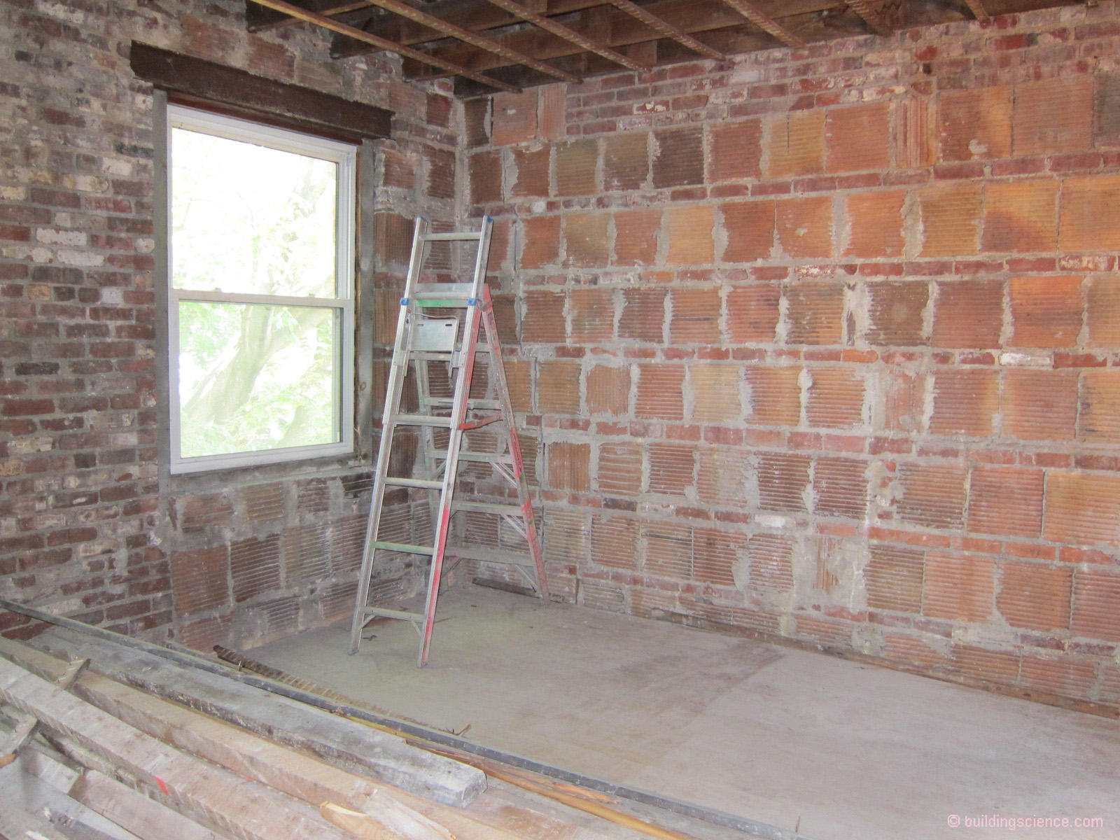 This is not our house, but this is what ours looks like, without the brick wythe in between each tile course. Note the ribbing for plaster adhesion
