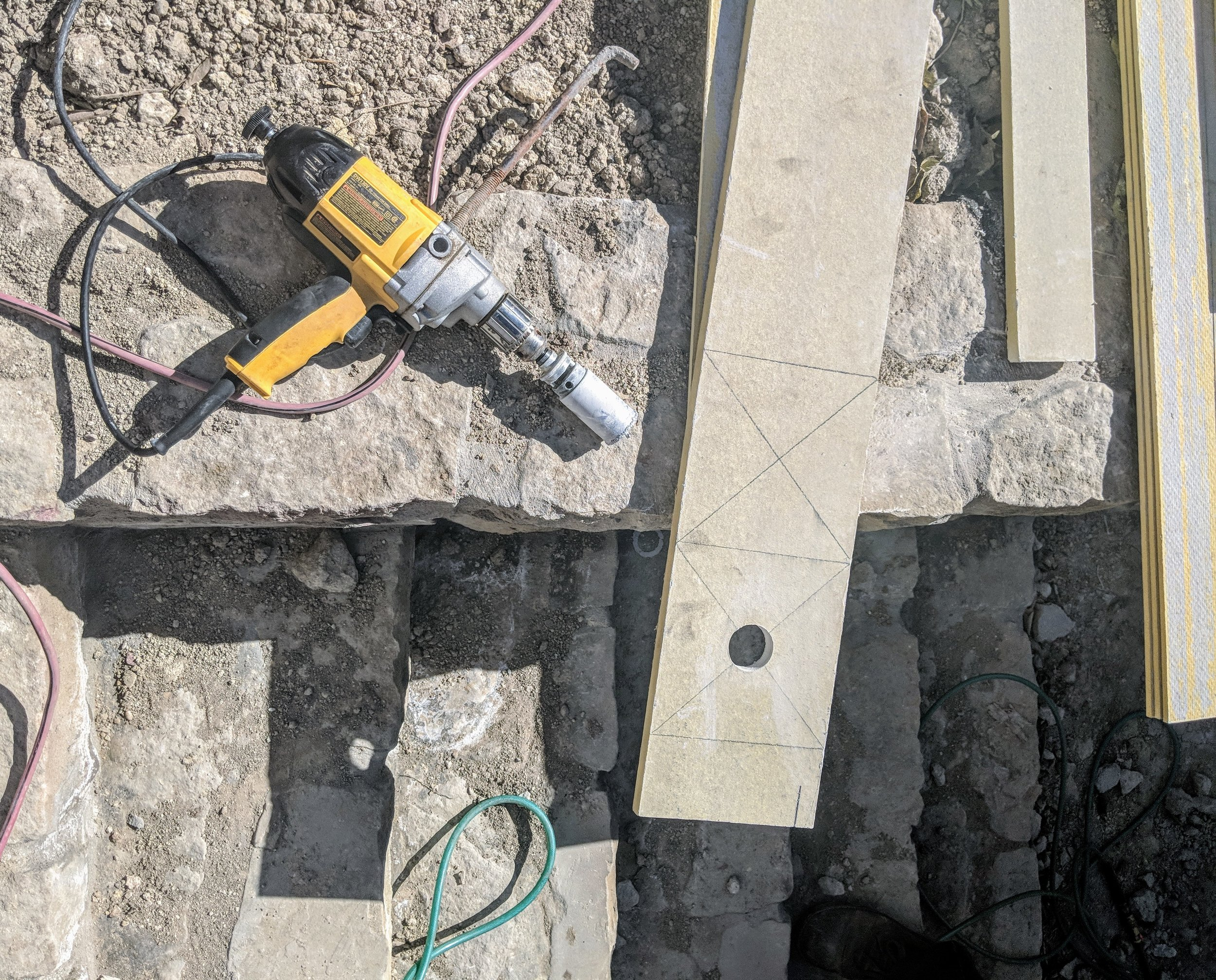 """If we don't have Sturdimounts on hand, we will use a hole saw to cut through a 3/4"""" trim board, works just as well. Note: hole saws are not part of the average cornice crew or framer's tool bag. This is our own equipment."""