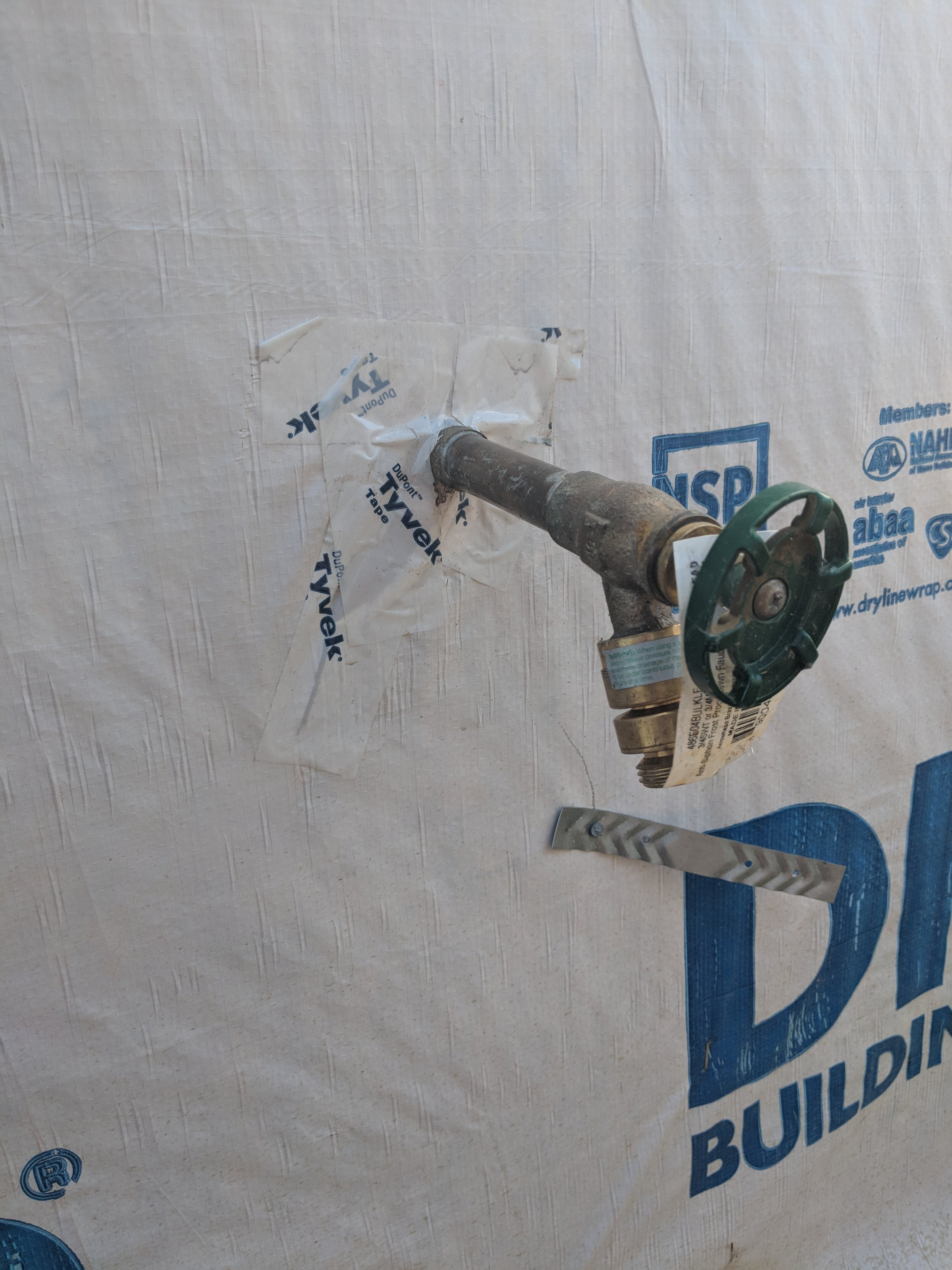 This is not our job site. But this is a typical flashing job on a through-wall pipe. How durable do you think that tape, does it look like its making good contact with the pipe to form a tight seal? As the metal expands and contracts and the wood frame moves, does this look like a seal that will hold up?
