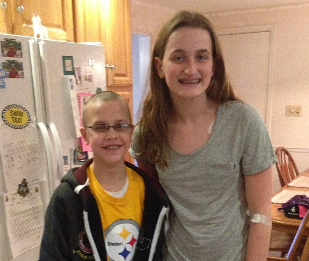 Shannan, with the young boy who saved her life.