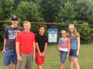 The Thomas family, posting warning signs at their pool club