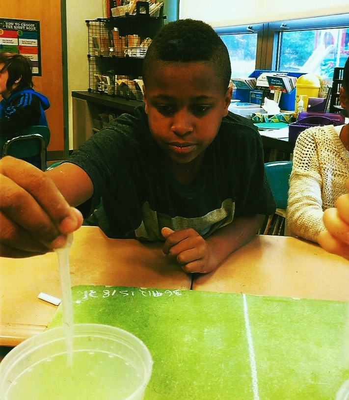 A student experiments with creating environmentally friendly household cleaners in the Foundation-funded project.