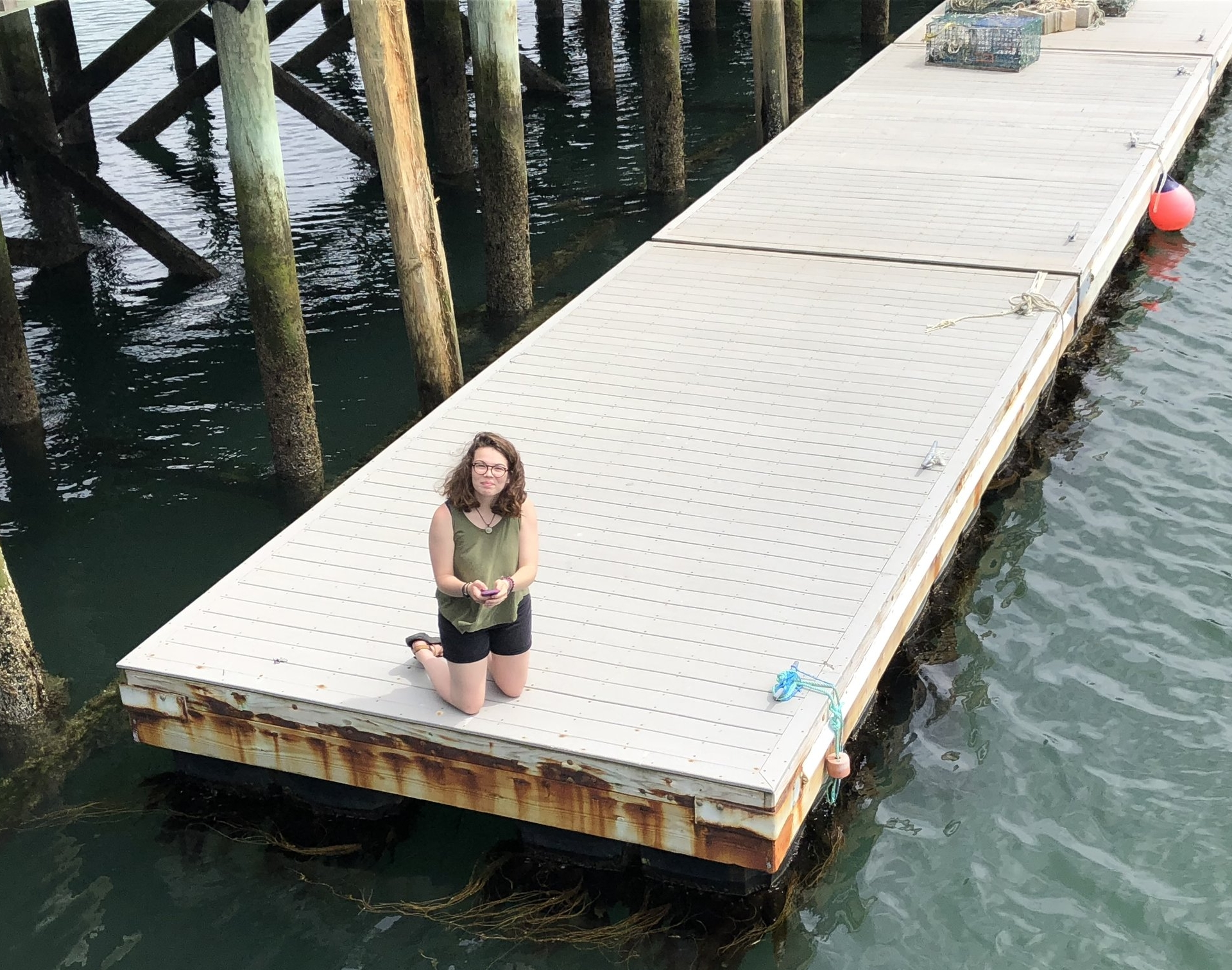 A volunteer measures the color of Casco Bay.