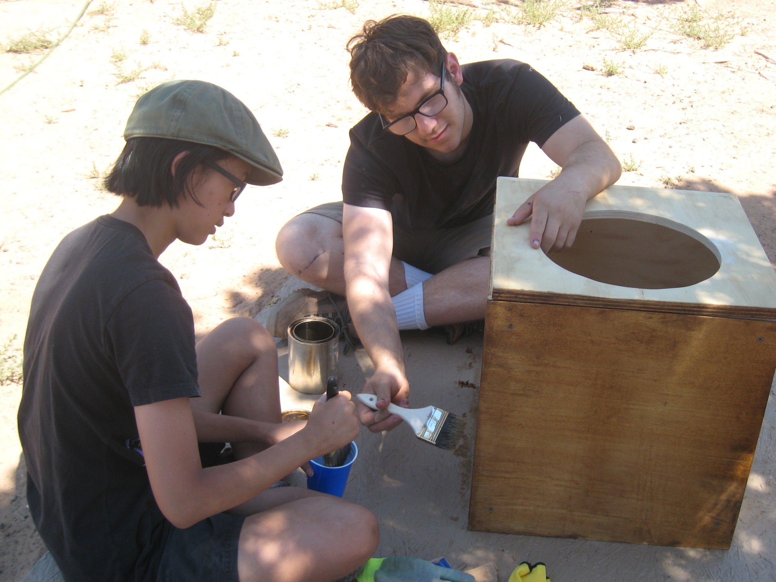 UCLA Engineers Without Borders students prepare a sink for installation in the house.