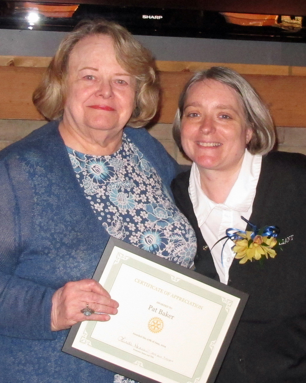 Pat Baker receiving recognition for all here hard work as a former Rotarian.. along side Linda Menear