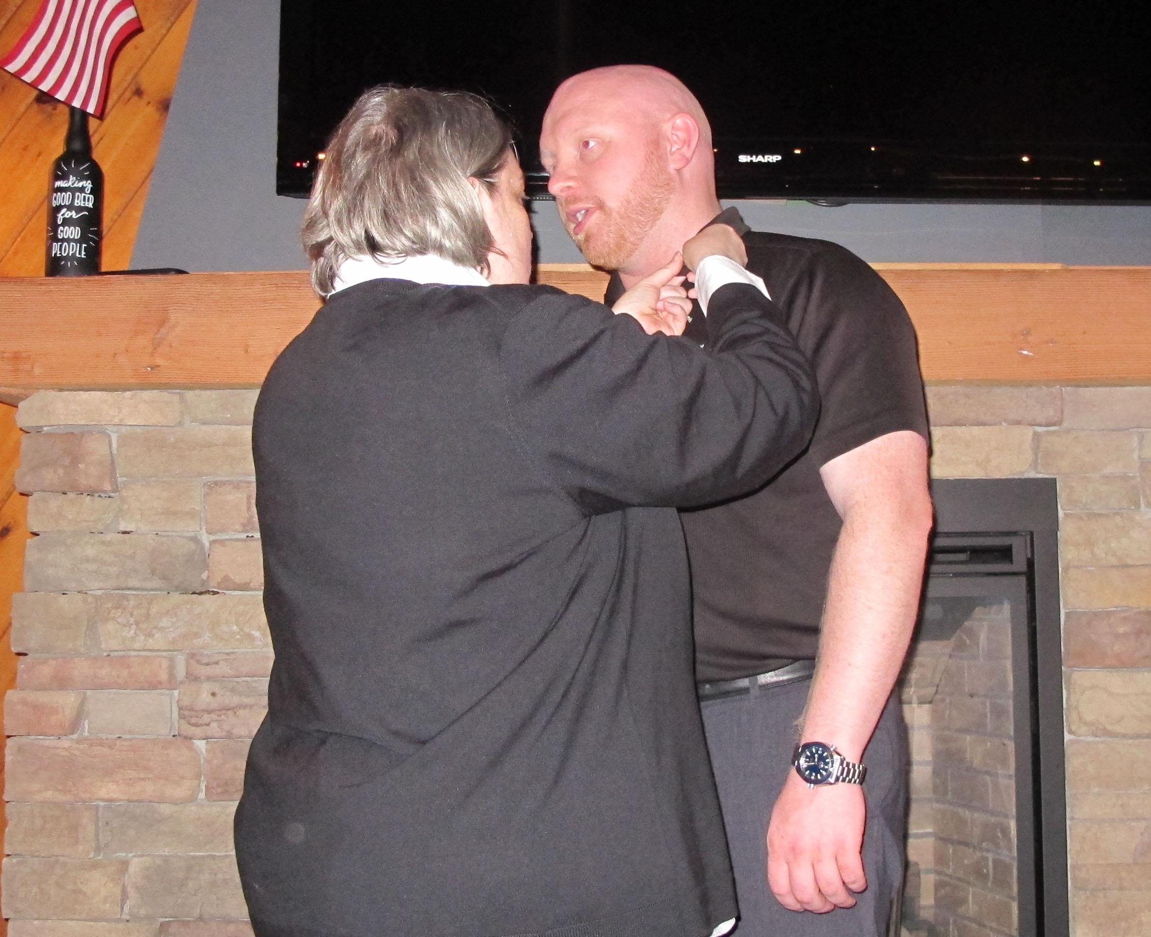 Incoming Pres Steve Drexler getting pinned president by outgoing president Linda Menear