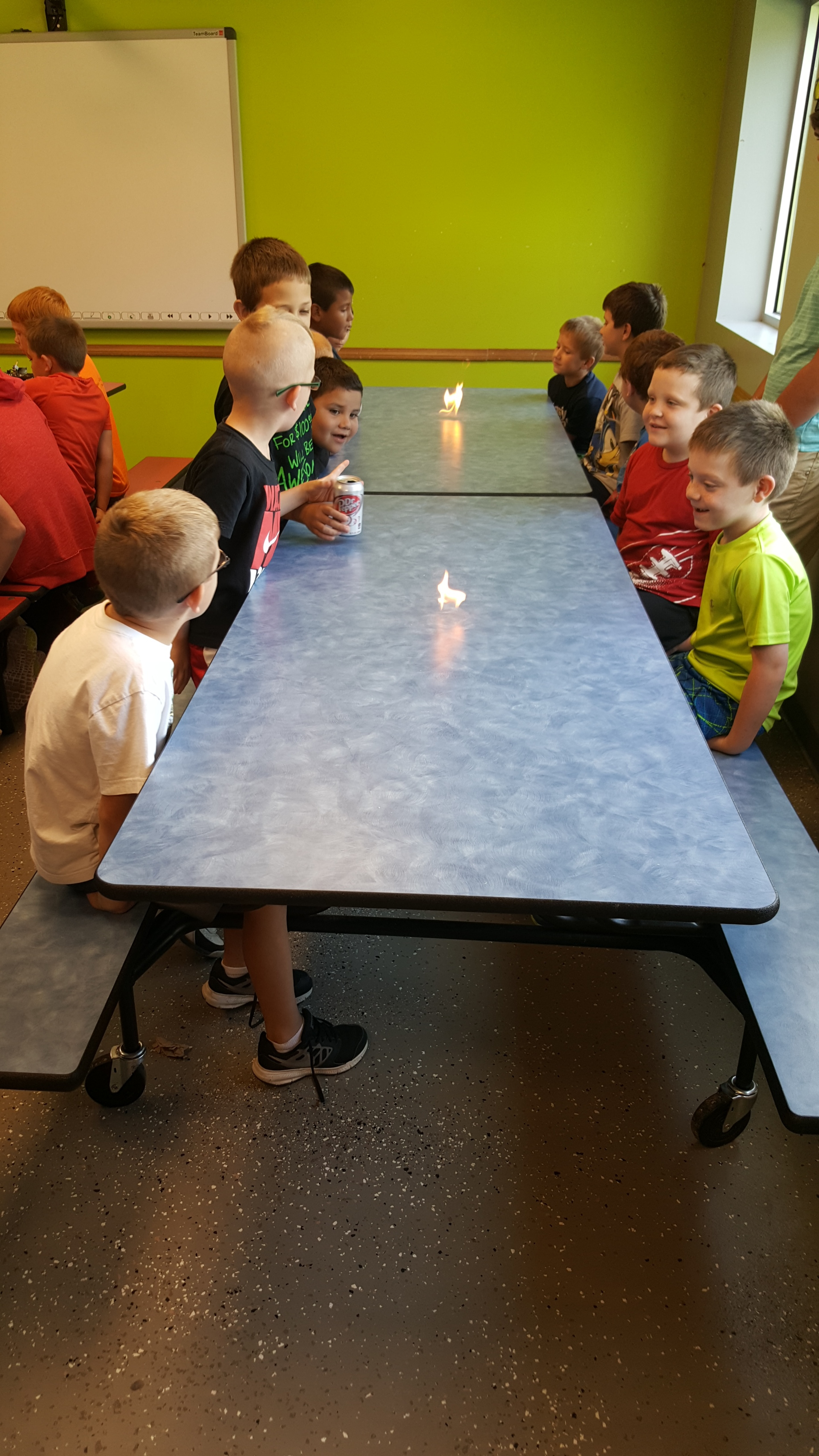 The table's on fire! Is nobody worried here? The kids seem to think it's pretty cool!