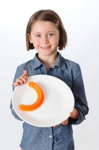Ruby Lucken, who spends much of her free time inventing things, created the Food Cubby for kids who want plates where foods don't mush up together. Photo by Bill Brown Photography.