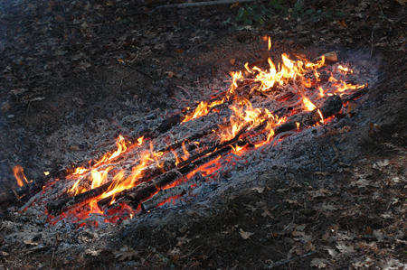 Burning charcoal in a trench. There is a trench, this is the end of the burn when it's full of charcoal.  Video here .