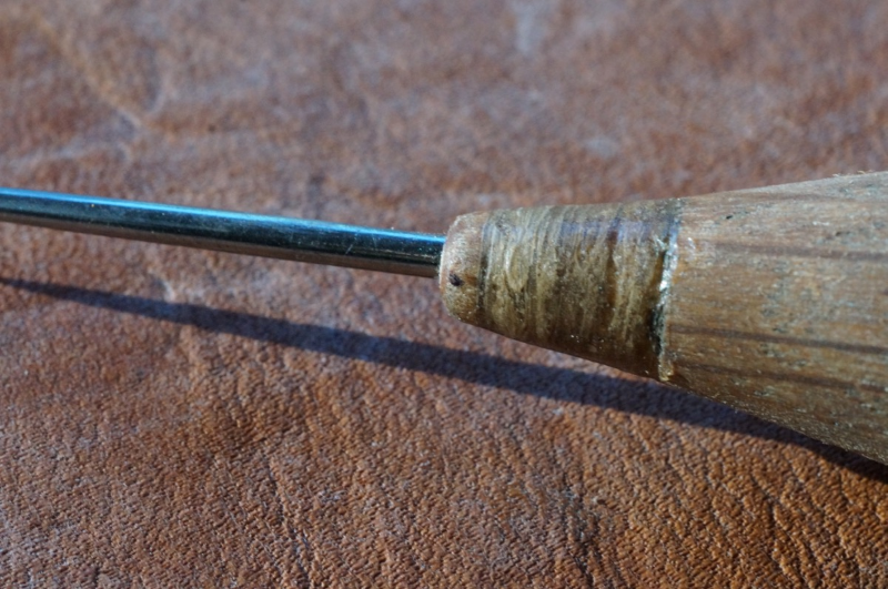 Sinew wrapping.  Some may understandably doubt the ability of this wrapping to keep the wood from splitting, but after shooting blunt practice arrows wrapped like this into stumps, rocks and dirt over and over again, I have no doubts at all.