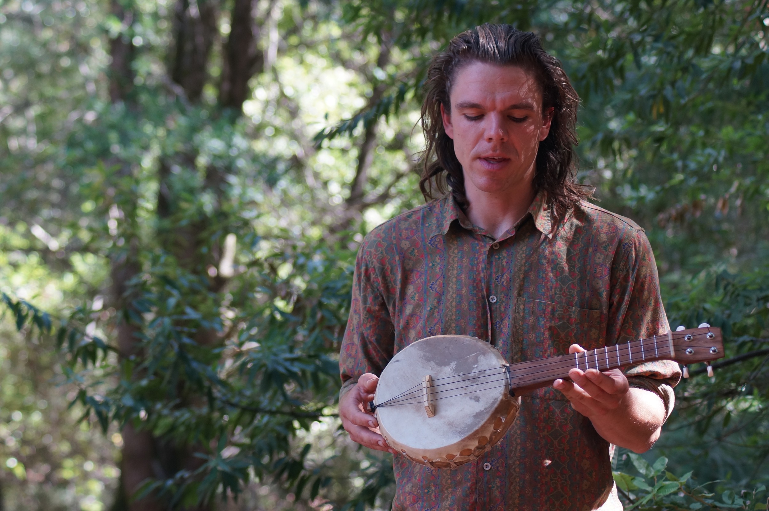 The talented Ira showing off his gourd and rawhide ukelele.  Video here .