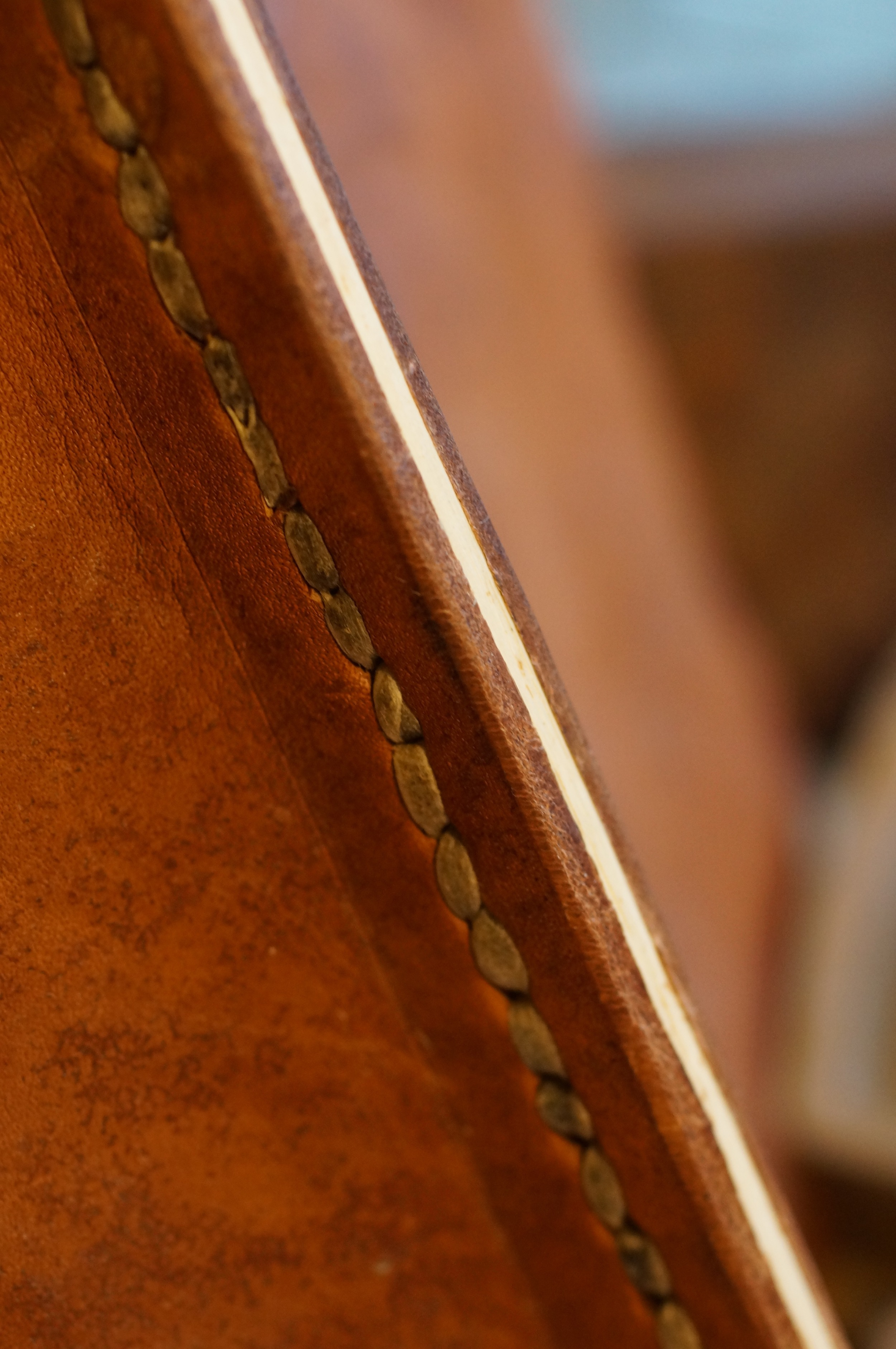 A wood and leather seam with rawhide stitching. An experiment for another abandoned project.