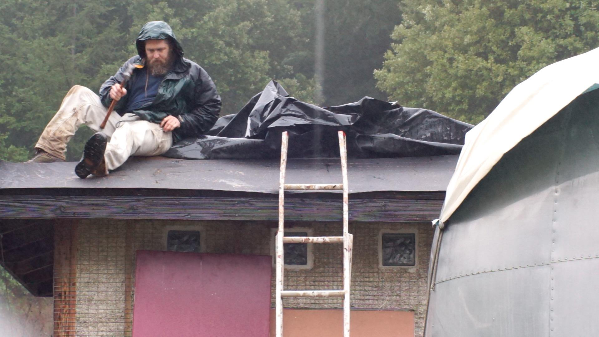 Emergency roof repairs in the rain.
