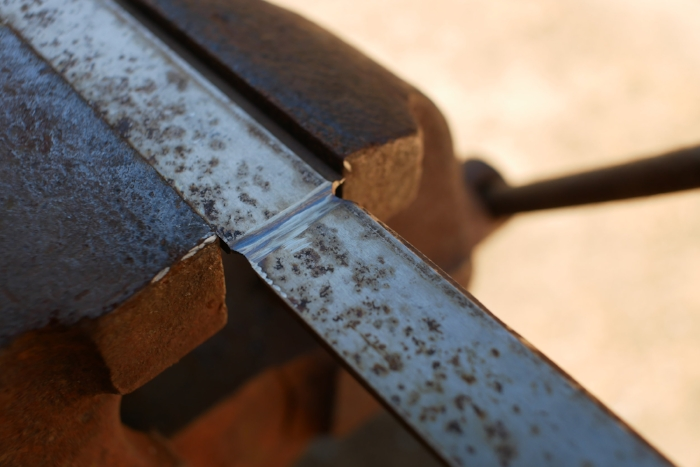 Planer blades can't be drilled or sawn easily. To shorten, grind from both sides until thin, clamp in a vice, then break off.