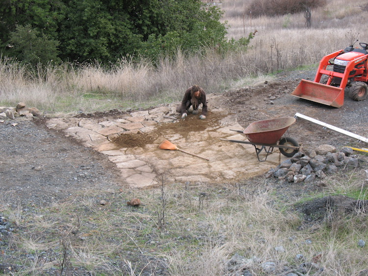 Building an armored crossing for a seasonal creek. This solution can be better than a culvert sometimes, and often a lot cheaper.