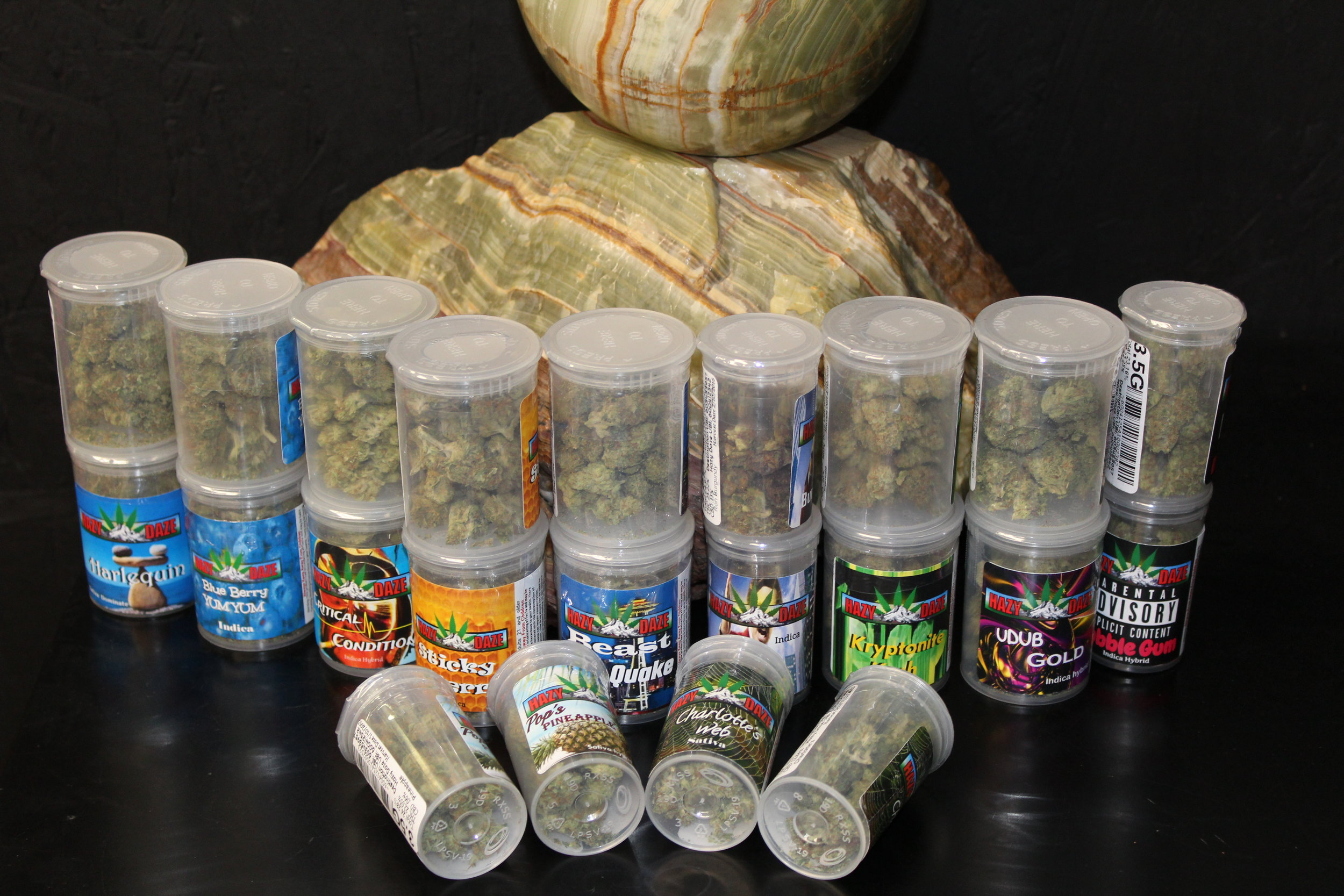 These are the old Hazy Daze marijuana flower packages. Haze Daze has recently began using premium etched glass jars. Some of Hazy Daze's most popular strains are Ron Burgundy, Beast Quake, and OG's Pearl.