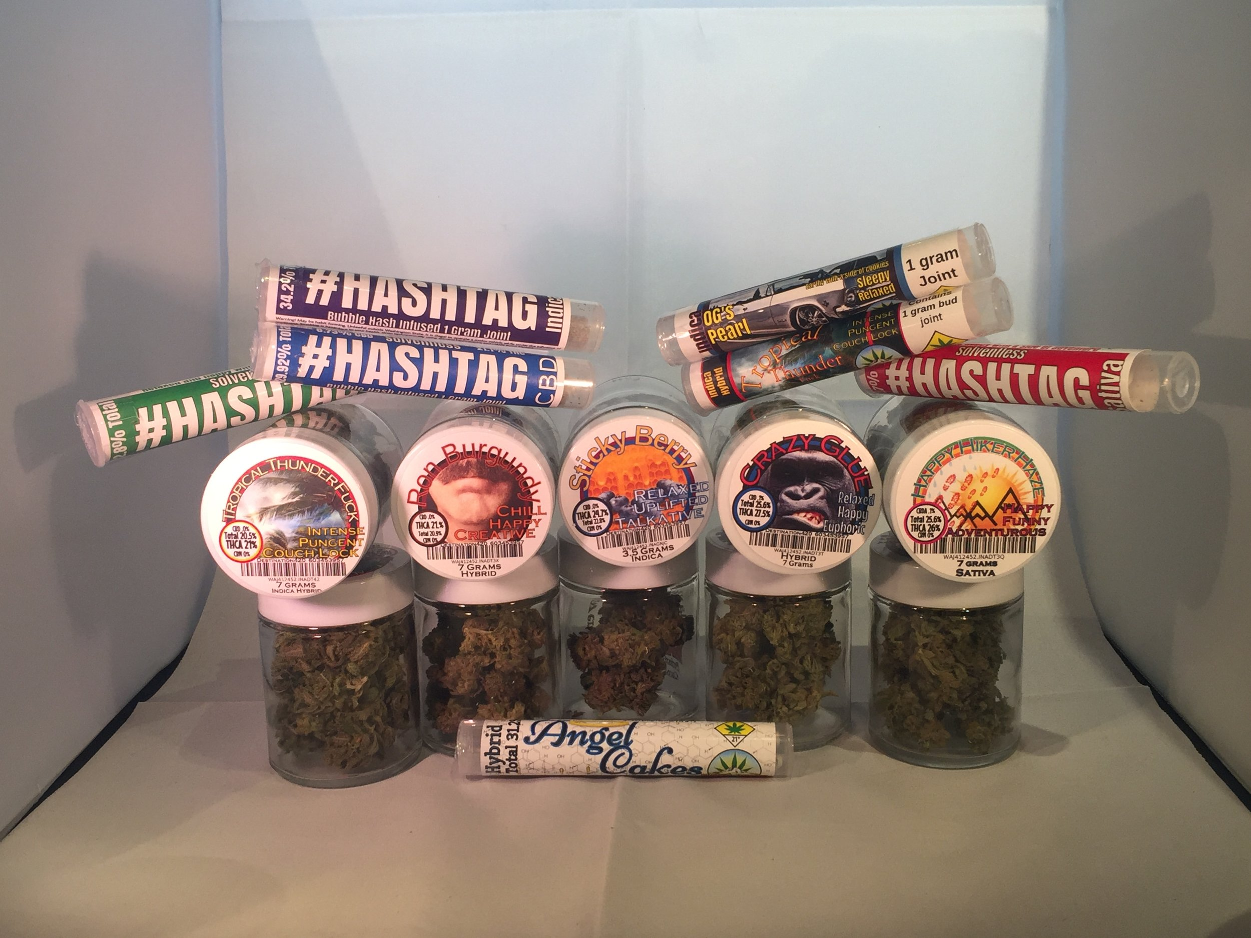 These are some of the smokeable marijuana products that are produced by Hazy Daze Growers. Hazy Daze's newest product in this picture are the #Hashtag Infused Joints. #Hashtag infused joints contain flower and BHO.