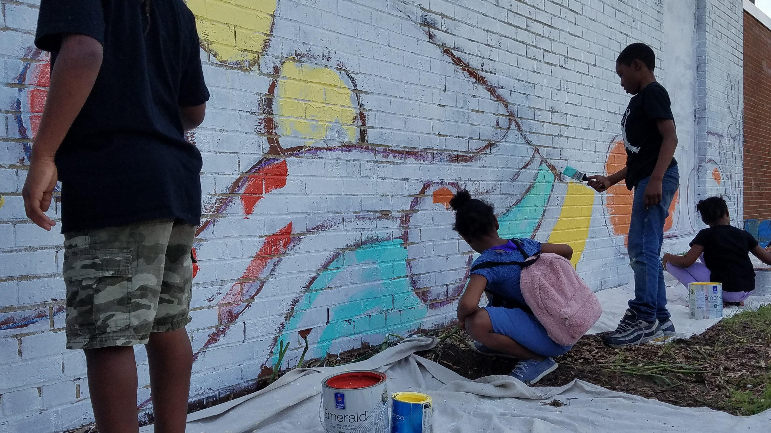 Members helped paint the mural during the Love Your Block celebration.
