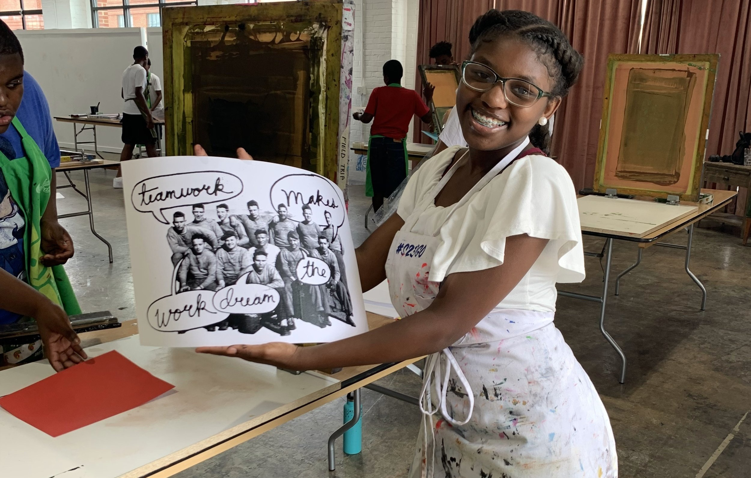 A'Landa shows off her print made at Studio Two Three.