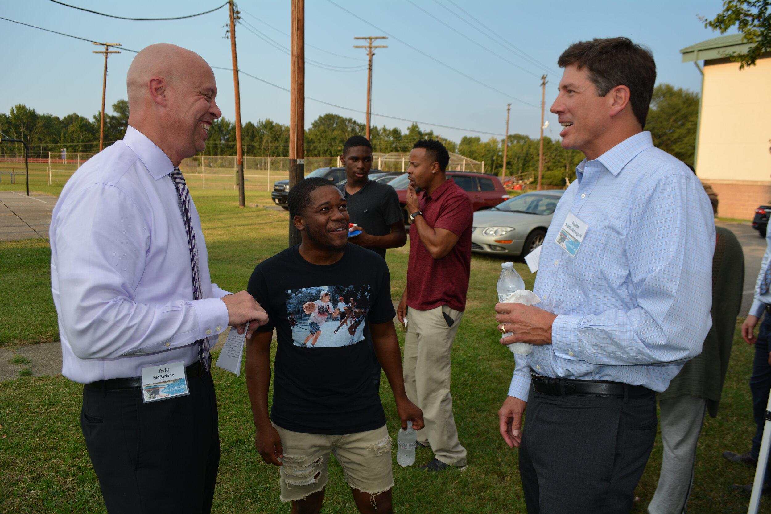Todd McFarlane, president & CEO, and alum Bratavious Watts enjoy a laugh with longtime friend Austin Brockenbrough IV.