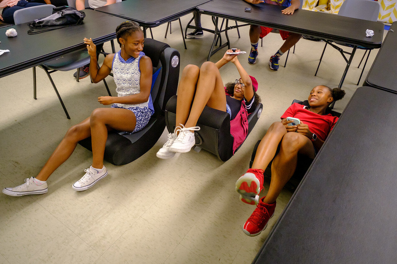 Teens relax in the Club's new gaming chairs.
