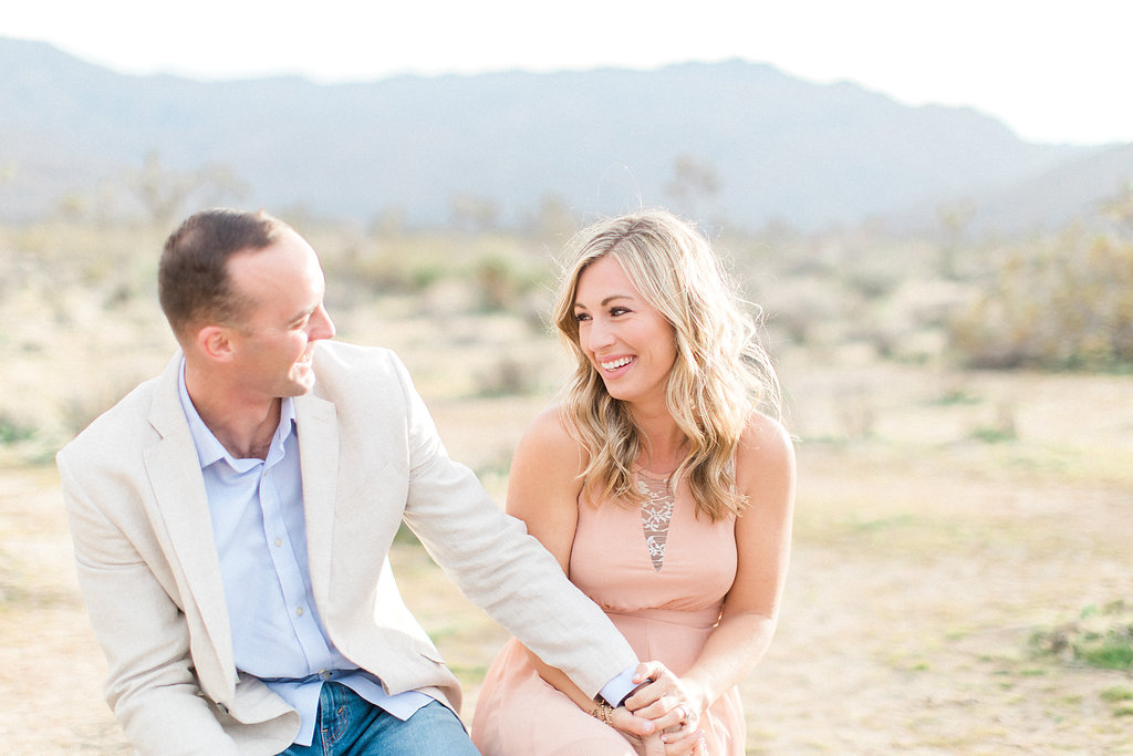 Joshua Tree Engagement Session | What to Wear for Pictures | Southern California Wedding Photographer | Mastin Labs Fuji Film | Fine Art Photographer | Desert Shoot | Couple Laughing.jpg