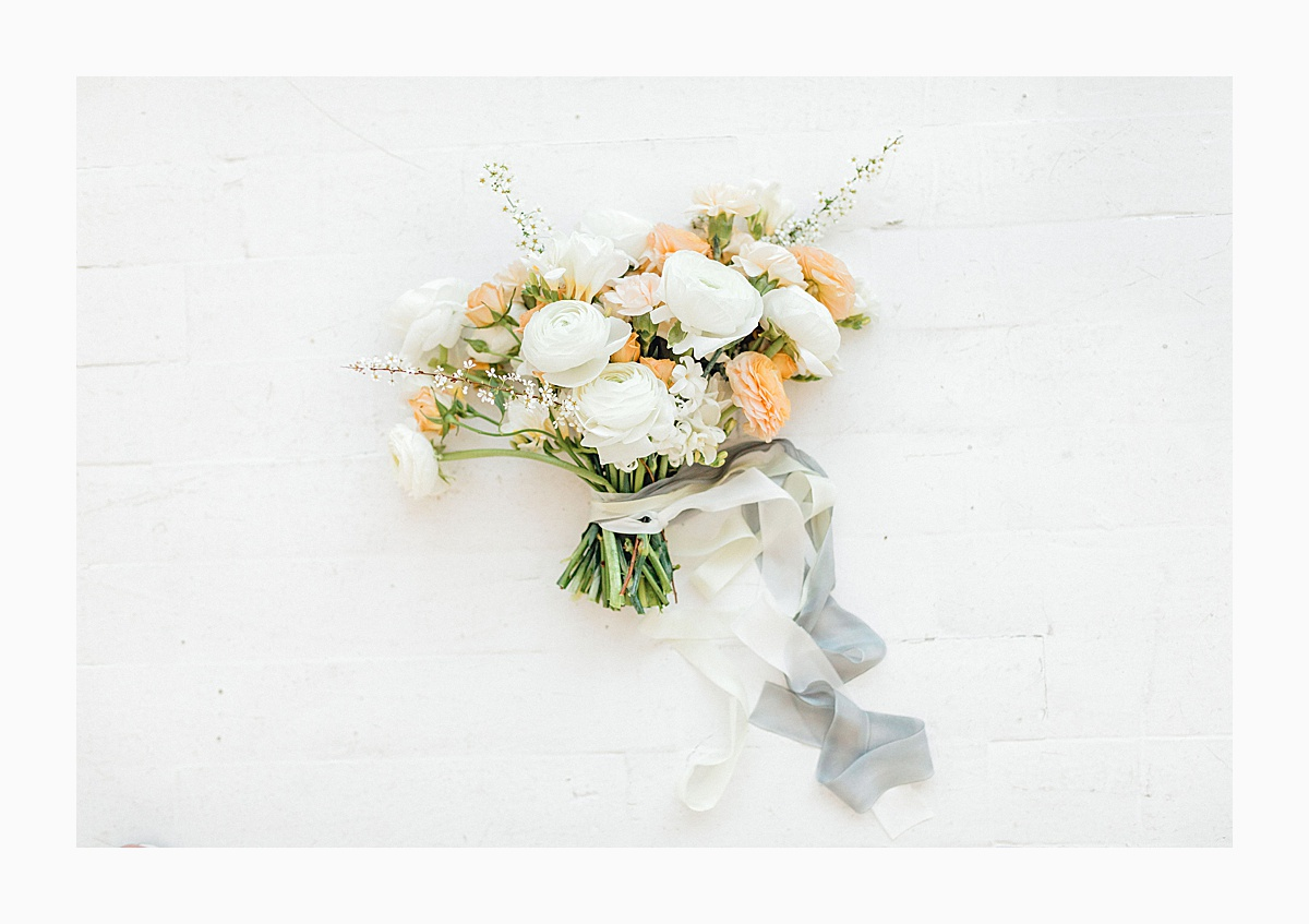 The Bemis Building in downtown Seattle is one of my favorite places to use for photo shoots!  This styled bridal shoot with touches of peach and white was dreamy.  #emmarosecompany #kindredpresets #seattlebride_0006.jpg